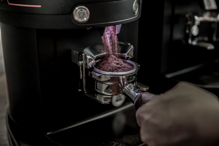 Human Hand Human Body Part Indoors  Close-up One Person Hand Machinery Selective Focus Holding Making Occupation Preparation  Real People Technology Coffee Maker Working Metal Heat - Temperature Finger Container