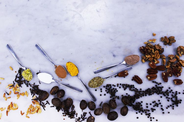 High angle view of spices with spoon on floor