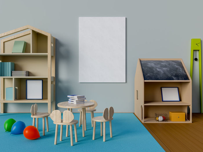 Mock up poster in kid room Table Indoors  Chair No People Absence Seat Empty Furniture Wall - Building Feature Frame Still Life Picture Frame Business Copy Space Home Interior Wood - Material Education Publication Blue Book Blank Kid Room