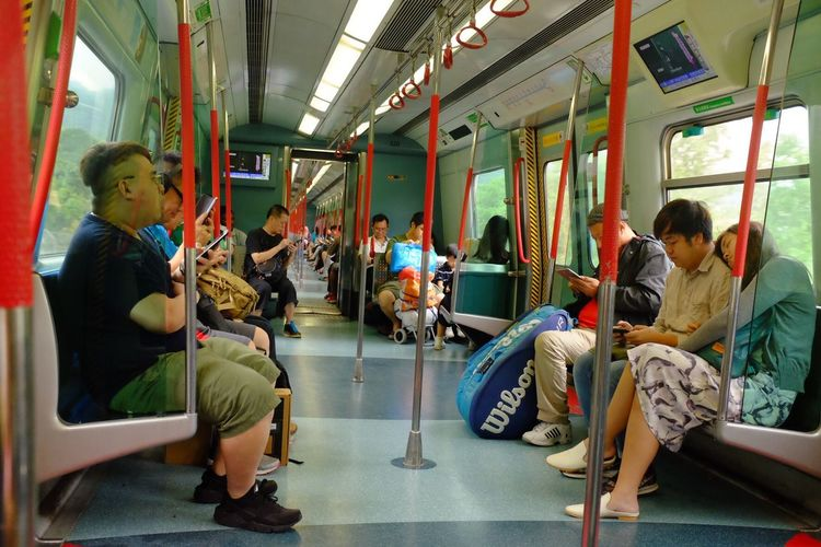 Vehicle Interior Public Transportation Train - Vehicle Transportation Sitting Subway Train Real People Vehicle Seat Full Length Passenger Women Large Group Of People Indoors  Men Day People Adult HongKong Mrt Subway Interior