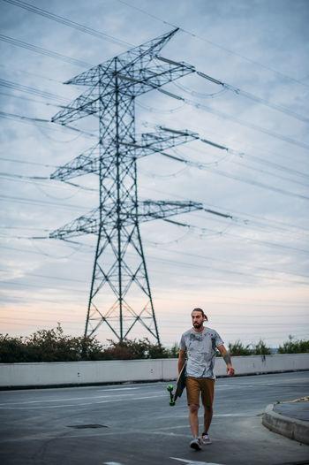 Full length of man standing on road against sky