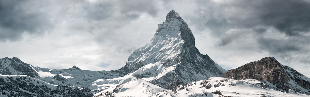 panoramic view to the majestic Matterhorn mountain, Valais, Switzerland Mountain Snow Matterhorn  Valais Overcast Cloudy Panorama Panoramic Mountain Peak Beauty In Nature Scenics - Nature Winter Environment Landscape Tranquil Scene Formation Rocks Nature Mountain Range Switzerland Outdoors Tranquility Stay Out