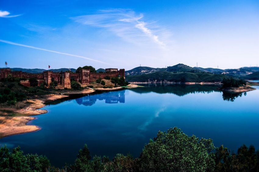 Peculiar Dream Reflection Water Blue Lake Nature Sky Beauty In Nature Tranquil Scene Scenics No People Tranquility Mountain Trees Island Peculiar Nature Medieval Medieval Castle Clouds And Sky Water Reflections EueEm Nature Lover EyeEm Best Shots EyeEmNewHere EyeEmBestPics Castle Silves Lost In The Landscape