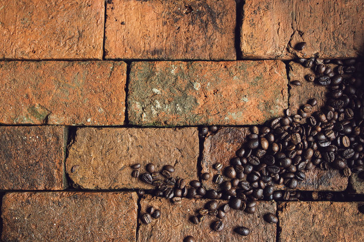 High Angle View Of Coffee Beans On Bricks