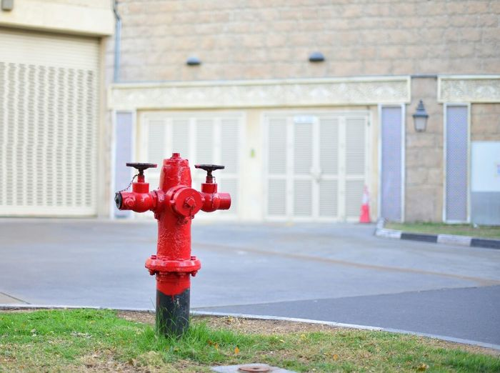 Fire Hydrant At Roadside Against Building