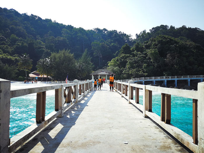 Pulau Redang, Malaysia. Tree Plant Nature Water Railing The Way Forward Day Bridge Direction Sky Real People Connection Group Of People Beauty In Nature Architecture Built Structure Mountain Bridge - Man Made Structure Walking Outdoors Footbridge Ocean Snorkeling Malaysia Jetty Travel Destinations Tropical Island Turquoise Water Beautiful Nature