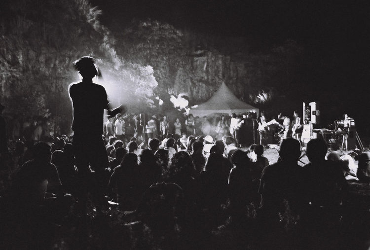 One man among the crowd and the music.~ Blackandwhite Bw_collection Cigarette  Concert Concert Photography Dark Enjoying Life Enjoyment Festival Festival Season Film Film Photography Illuminated Large Group Of People Leisure Activity Lifestyles Live Music Monochrome Mountain Music Music Is My Life Night Outdoors Smoke Thailand