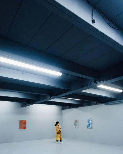 Art student One Person Architecture Indoors  Illuminated Built Structure Women Real People Walking Lighting Equipment Architectural Column Full Length Standing Light Waiting Warm Clothing Day Art Gallery Exibition Exibition Hall Art Student Painting Museum Art Museum