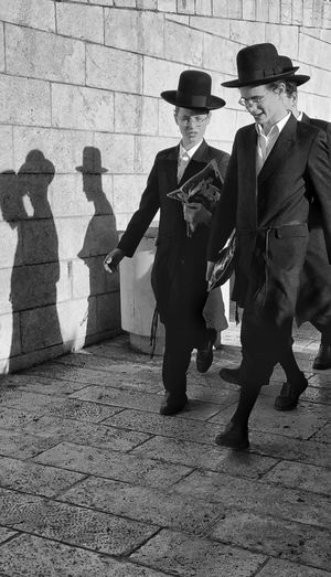 Shadow and light in Israel EyeEm Street Photography Awards 2018 Real People Men Shadow Full Length Clothing Hat Day