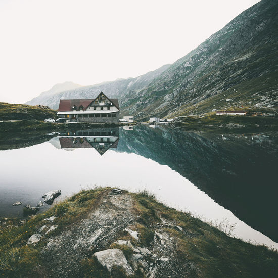 Mountain View Nature Architecture Beauty In Nature Building Exterior Built Structure Clear Sky Cold Temperature Day Lake Landscape Mountain Mountain Range Mountains Nature No People Outdoors Reflection Scenics Sky Snow Tranquil Scene Tranquility Travel Destinations Water