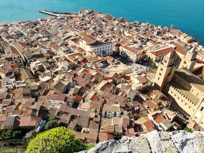 Rooftops of Cefalu seen from la Rocca Sicily Rooftops Roofs Of Cefalu Sicily Sicily, Italy Afternoon Glow Happiness Traveling Traveling Sicily EyeEm Selects Water Sea Beach Sunlight Sky Horizon Over Water Coast Calm Countryside Country House Mid Distance