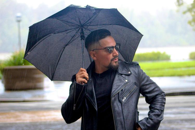 man standing on wet glass during rainy season