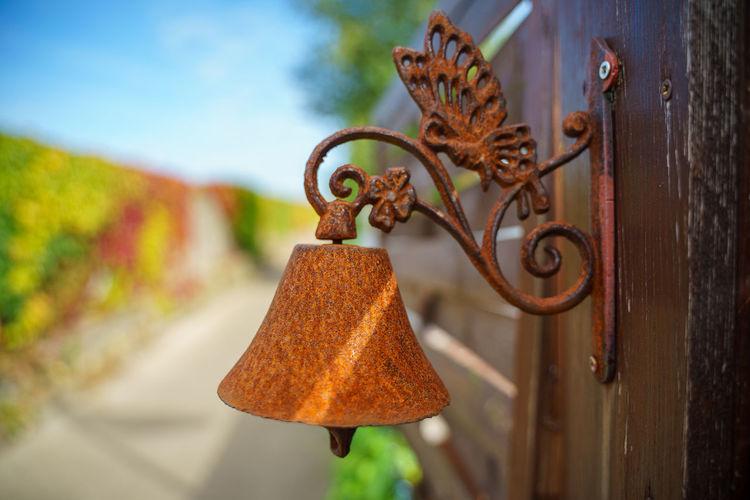 Close-up of rusty hanging on metal door