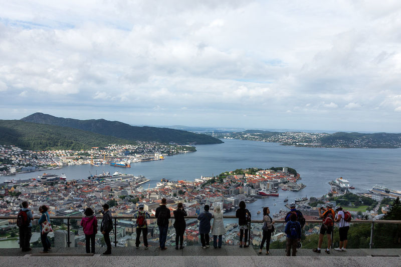 Urban landscape in Norway, Bergen Bergen Bergen,Norway Norway Travel Travel Photography Adult Architecture Built Structure City Cityscape Cloud - Sky Crowd Day Group Of People Large Group Of People Leisure Activity Lifestyles Looking At View Men Nature Outdoors Real People Sea Sky Water Women