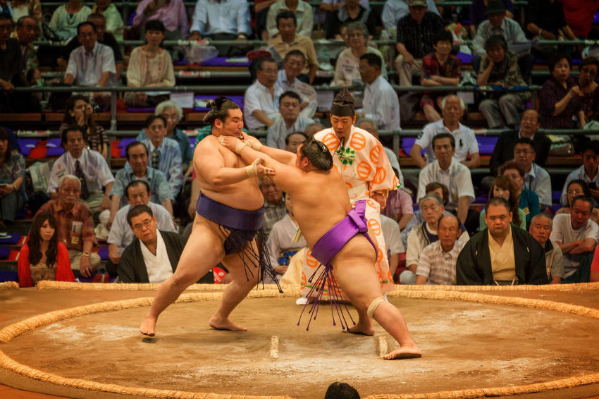 Sumo wrestlers during the contest Fight Japan Nagoya Tradition Adult Athlete Attack Competition Competitive Sport Day Gymnasium Indoors  Men People Performance Shirtless Sport Sports Sportsman Stadium Sumo Tournament Wrestling