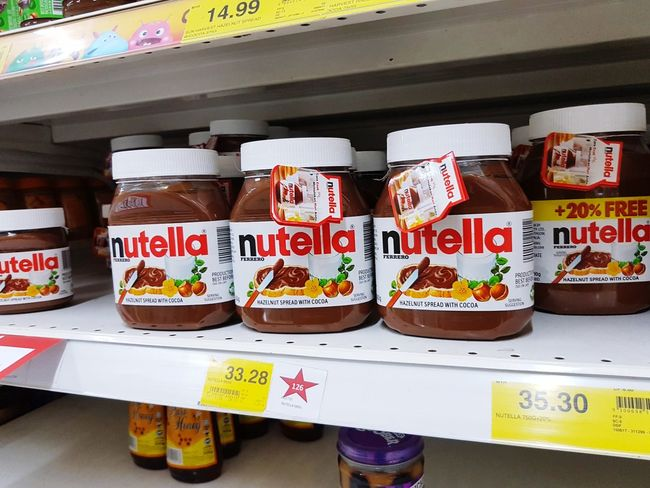 Nutella brand product on a retailer shop shelf Business Finance And Industry Food Variation Store Business Market Unhealthy Eating Retail  Price Tag Day Indoors  No People Sweet Food Text Nutella Nutrition Ingredient Cooking Chocolate Flavor Taste Sweet Nutellalove Freshness Brand
