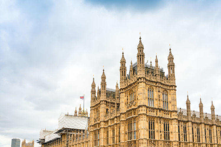Low angle view of palace of westminster against sky