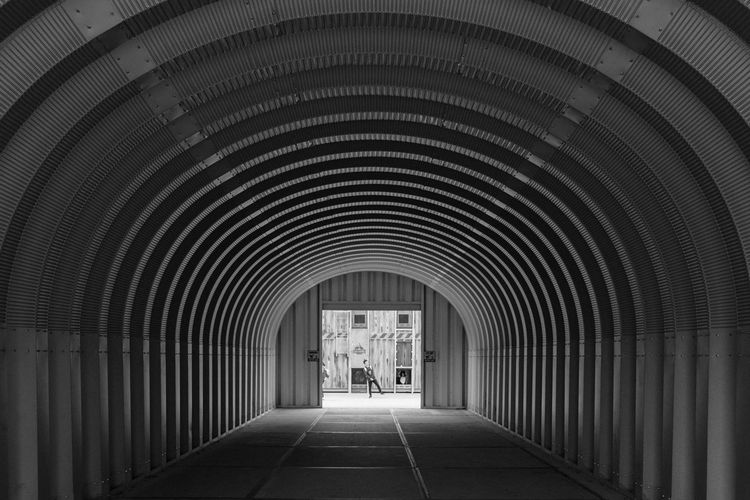 The Tunnel EyeEm Best Shots Finding Lonely Lost Arch Architecture Built Structure Corridor Darkness And Light Day Diminishing Perspective Discovery Eye4photography  Geometry Indoors  Mystery One Person People Real People Symmetry The Way Forward Tunnel