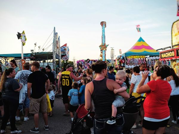 Nebraska State Fair - Grand Island, Nebraska August 2016 Americans Baby Camera Work Carnival Rides Casual Clothing Color Photography Crowd Cultures Daytime Eye For Photography EyeEm Best Edits EyeEm Gallery Fairgrounds Fujifilm Getty Images Lifestyles Nebraska Outdoors Photo Essay Real People Selects State Fair Streetphotography Summertime Walking Around