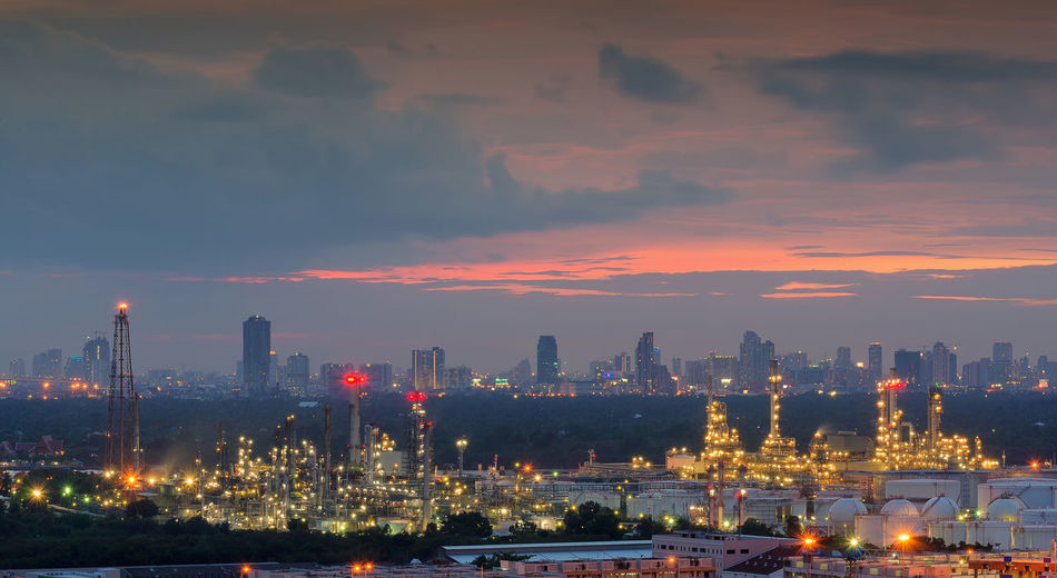 Bangchak Petroleum's oil refinery, Phra Khanong District, Bangkok, Thailand Bangchak Cityscape Architecture Building Building Exterior Built Structure City Cityscape Factory Illuminated Industry Night No People Oil Outdoors Petroleum Sky Skyscraper Smoke Stack Sunset Urban Skyline