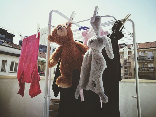 Hanging Carefree Women Leisure Activity City Outdoors Adults Only Sky Adult People Togetherness Day Cultures Baby Stuff Life Changes Life Choices Toy Animal Stuffed Toy Teddybear Bear Teddy Bear Animal Representation Toy No People Childhood This Is Family