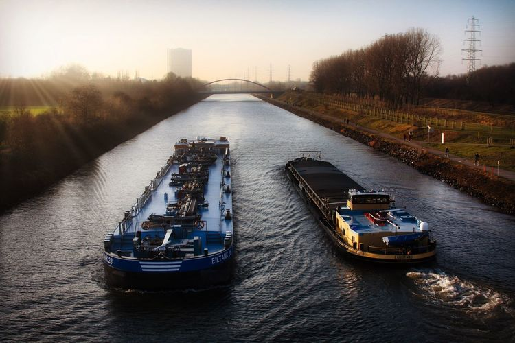 My Hometown. EyeEm Best Shots Sunset Canals And Waterways Boat Ship Transportation Mode Of Transportation Water Nature Architecture Nautical Vessel High Angle View River Day Building Exterior Freight Transportation Sky Outdoors