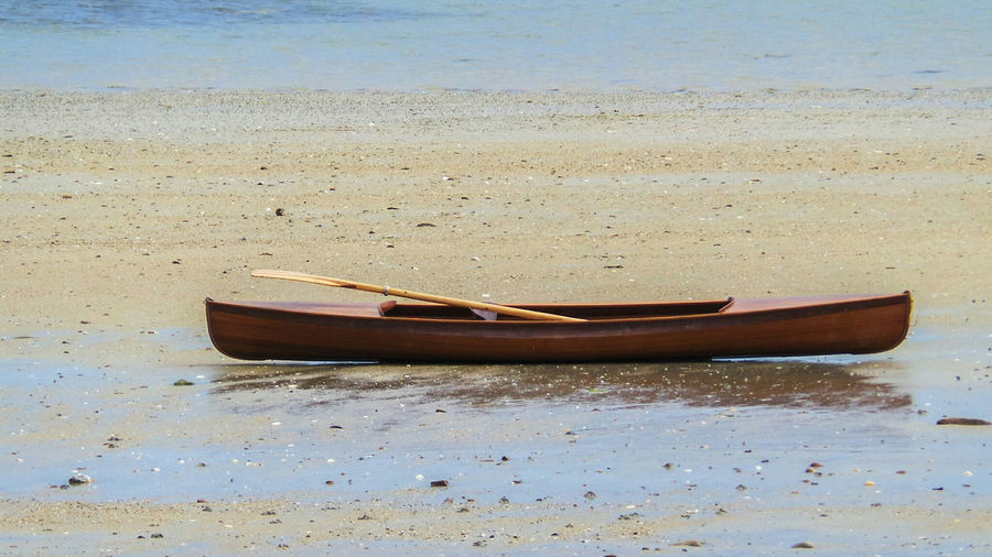 Nautical Vessel Beach Sand Transportation Wood - Material Outdoors Nature Rowboat Kayaking Kayak Kayaking In Nature Canoe Canoeing Exceptional Photographs Eye4photography  Eye4nature Sea Seascape Beauty In Nature Wood Canoe Wood Kayak Sea Life Sand And Sea Boat On The Beach Beach Photography