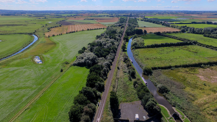 Aerial View Agriculture Beauty In Nature Canal Cultivated Land Day Farm Field Green Green Color High Angle View Landscape Linear Nature Non-urban Scene Outdoors Railway Track Remote Rural Scene Scenics Solitude Tranquil Scene Tranquility Transportation Wide