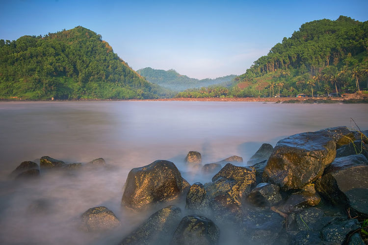 beach rocks INDONESIA Beauty In Nature Central Java Day Flowing Water Idyllic Indonesia_photography Land Mountain Nature No People Non-urban Scene Outdoors Plant Rock Rock - Object Scenics - Nature Sea Sky Solid Tranquil Scene Tranquility Tree Water