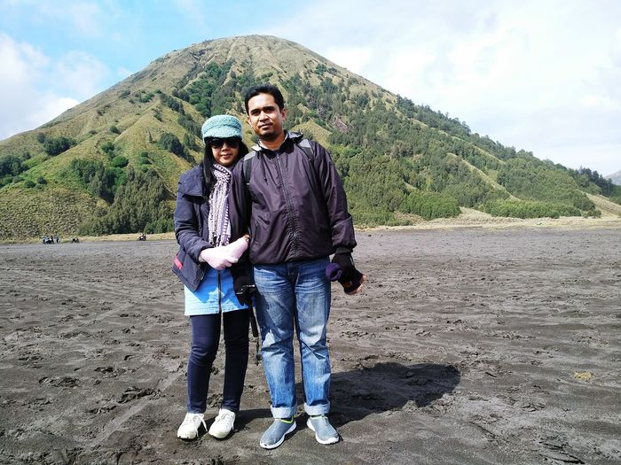Portrait of couple standing against mountain