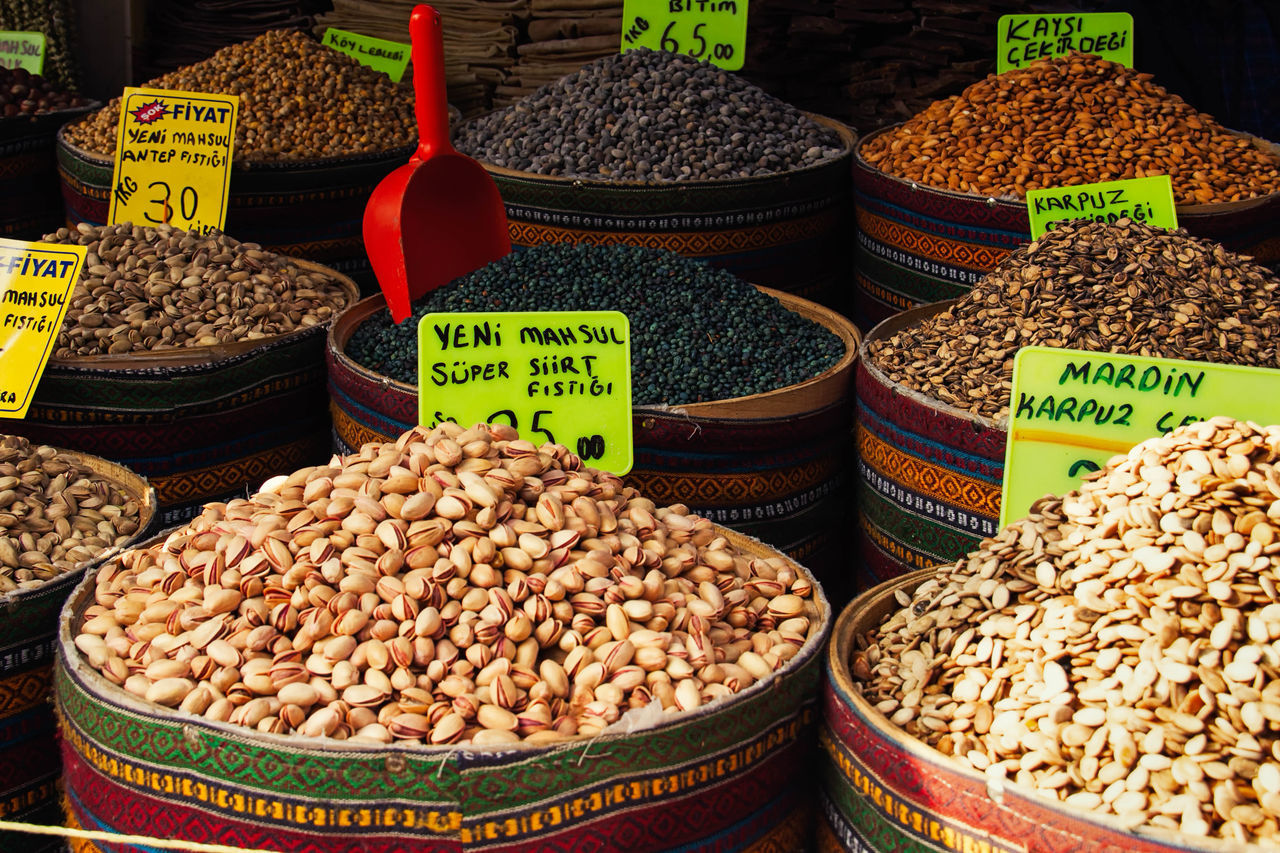food and drink, variation, food, market, for sale, market stall, retail, healthy eating, dried food, sack, choice, abundance, spice, still life, raw food, price tag, no people, legume family, freshness, outdoors, bean, grain, large group of objects, day, multi colored, heap, vegetarian food, close-up, nature