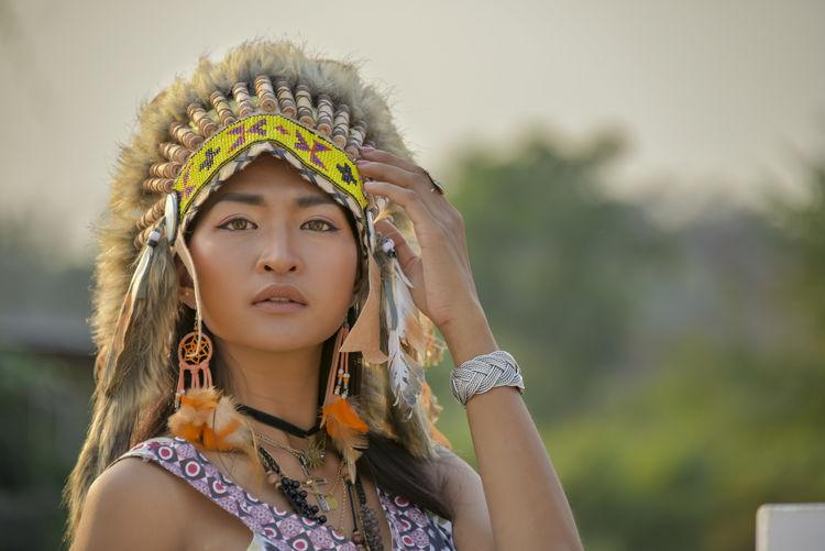 Portrait of beautiful woman wearing headdress
