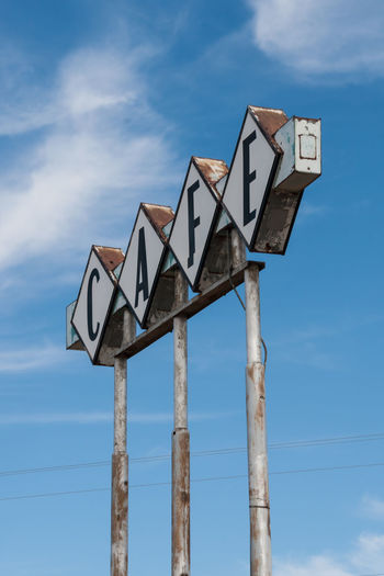 Old Cafe sign Abandoned Angled View Blue Cafe Sign Cloud Cloud - Sky Cloudy Day Derelict High Section Information Low Angle View Nature No People Outdoors Peeling Paint Pole Retro Route 66 Rusty Sign Sky Type Vega, Texas Vintage