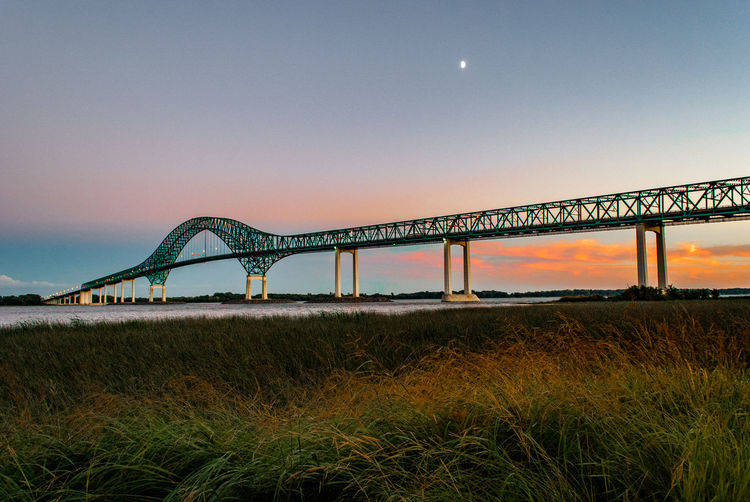 Laviollete Bridge in Trois Rivieres, Quebec at sunset. Marsh Quebec Sunset_collection Architecture Bridge Bridge - Man Made Structure Built Structure Canada Clear Sky Field Grass Low Angle View Marshland  Moon Nature No People Outdoors Sky Sunset Sunsets Transportation Water Wetlands