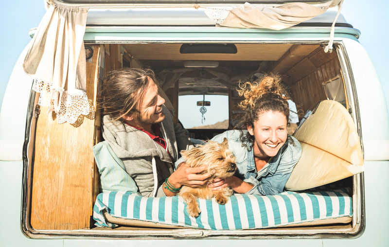 Happy Couple In Camper Van