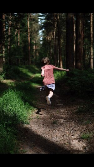 Full Length One Person Forest Tree Childhood Casual Clothing Child Nature People Motion Day Outdoors Girls Sports Clothing Adult Children Only Grass Young Adult The Portraitist - 2017 EyeEm Awards Live For The Story