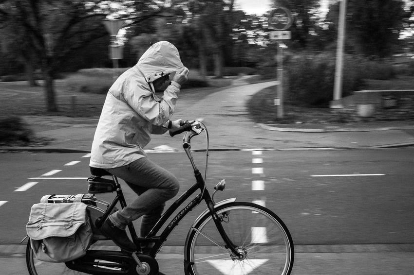 Bergen op Zoom [NL] - Citycentre park 'Anton van Duinkerken' - Cycling through the rain Bike Bicycle Wether Rain Wind Streetphotography Street Photography Blackandwhite Black And White Black & White Panning Motion Mobility In Mega Cities Press For Progress