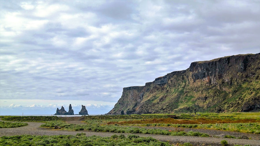 rock - object cloud - sky outdoors cliff sky Nature scenics beauty in Nature landscape no people þrídrangar Iceland_collection Iceland Rock - Object Cloud - Sky Outdoors Cliff Sky Nature Scenics Beauty In Nature Landscape No People Day Grass þrídrangar South Iceland