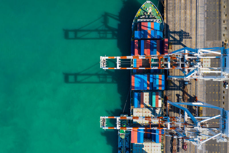 Shipping containers terminals loading and unloading by crane logistics and transportation