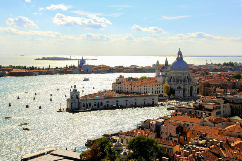 High angle view of santa maria della salute in city by canals