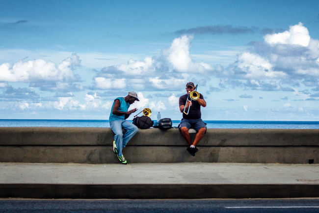 Caribbean Cloud - Sky Cuba Collection Cuban Cuban Life Friendship Horizon Over Water Leisure Activity Let's Go. Together. Lifestyles Malecon Men Musician Old Havana Outdoors Playing Music Real People Sea Sky Streetphotography Togetherness Travel Travel Destinations Two People Water