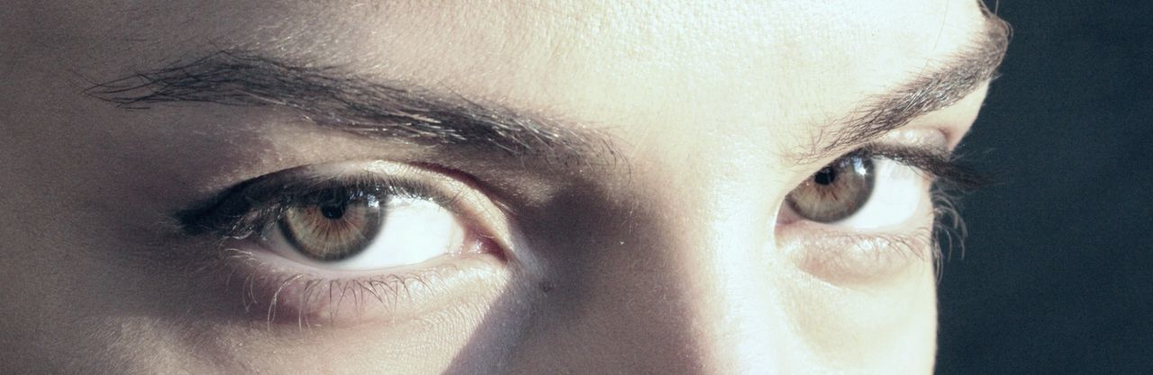 human eye, close-up, one person, eyelash, looking at camera, eyesight, portrait, human body part, eyeball, sensory perception, real people, eyebrow, iris - eye, day, people