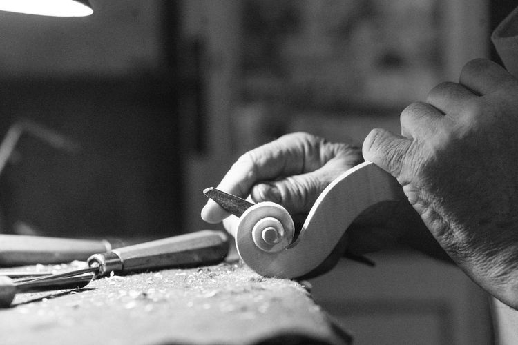 Cropped hand of man working at workshop