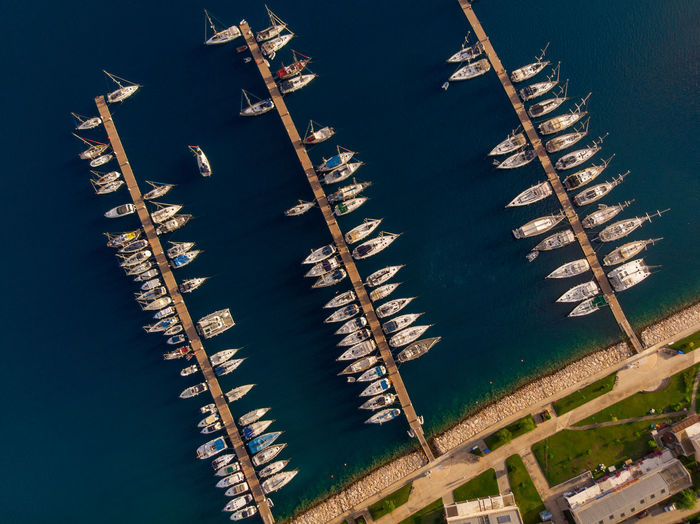 Aerial view of marina with lots of yachts. No People Nature Water High Angle View Transportation Day Outdoors Architecture Lake Connection Mode Of Transportation Nautical Vessel Built Structure Wood - Material Sailboat Pole Fence Drone  Aerial View Marina Yacht Ship Boat