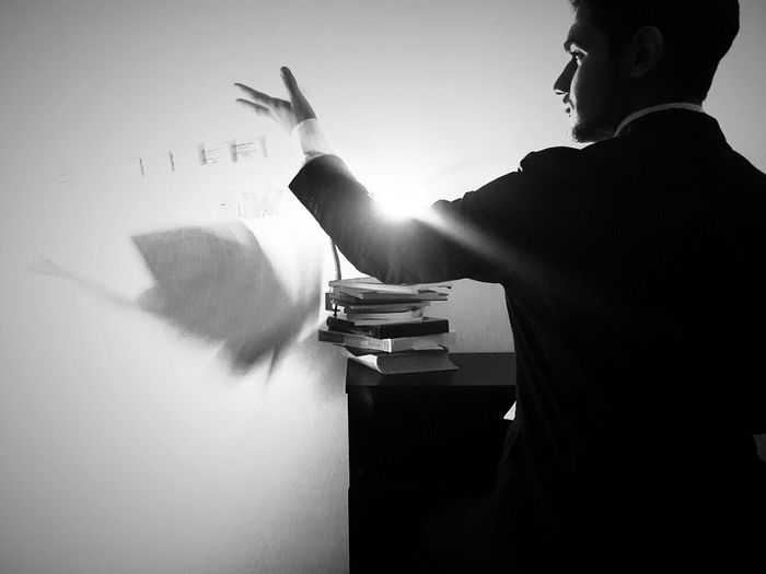 Businessman tossing papers