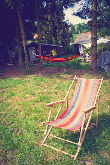 Absence Chair Chilling Day Deck Chair Easy Life Garden Grass Hammock Inviting Launcher Leisure Time Lifestyle Nature No People Outdoors Positive Relax Relaxing Moments Retro Style Summertime Sunlight Tree