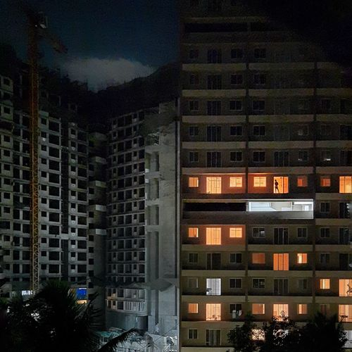 Buildings in city against sky at night
