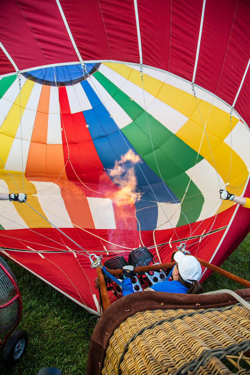 basket, multi colored, hot air balloon, transportation, day, outdoors, field, adventure, no people, ballooning festival
