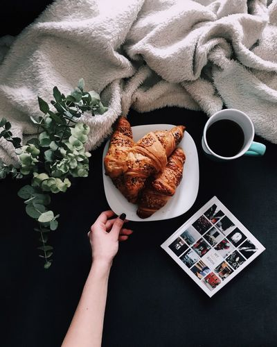 Food And Drink Human Hand Human Body Part Coffee Cup Coffee - Drink Indoors  Breakfast One Person Food Directly Above Drink High Angle View Croissant Real People Sweet Food Table Holding Home Interior Plate Bread