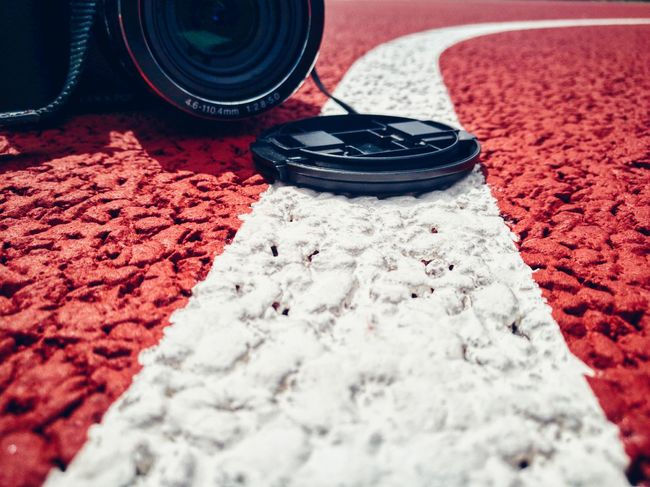 No People Red Close-up Day Light Contrasting Colors Basketball Court Textures Textures And Surfaces Camera - Photographic Equipment White Color Red Color Technology Photography Outdoors Nikon Camera Lights Photo Taking Photos Taking Pictures Camera On The Floor One Object Part Of A Camera